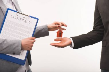 cropped image of estate agent giving key from house to costumer isolated on white