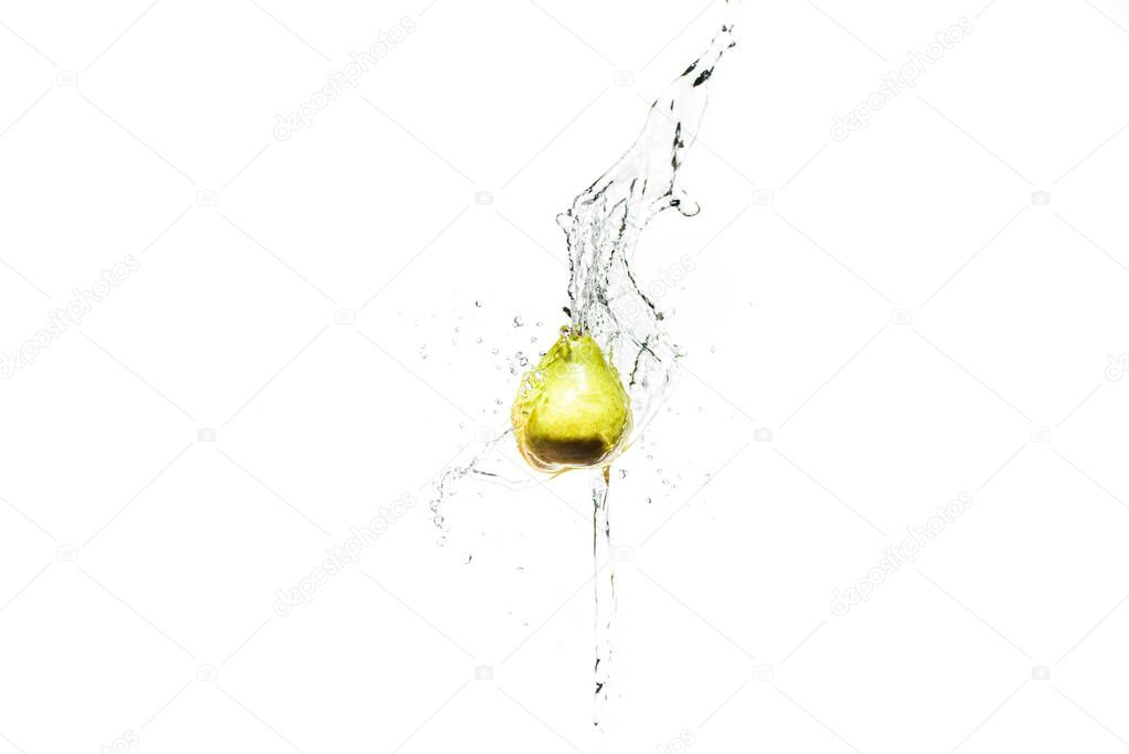 fresh ripe pear in water splashes isolated on white