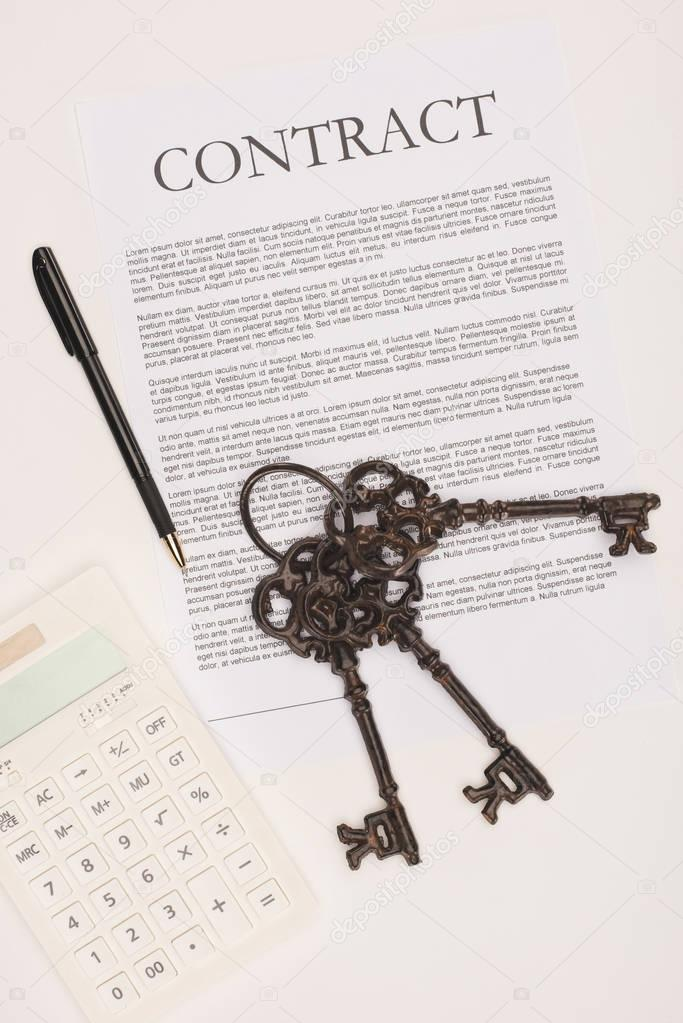 top view of contract with keys, house buying concept isolated on white