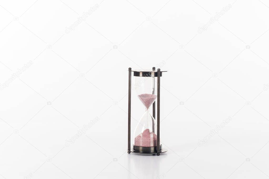close up view of sand clock isolated on white