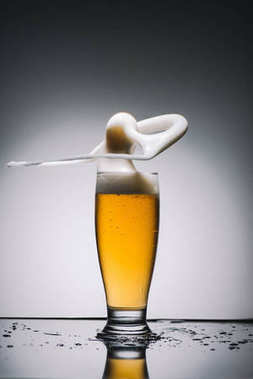 splashing foam of golden fresh beer