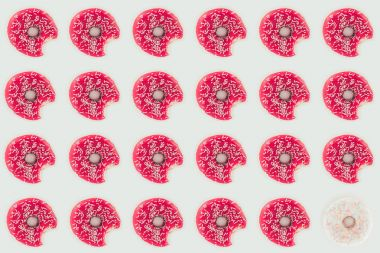 Top view of pink glazed doughnuts seamless pattern isolated on white stock vector