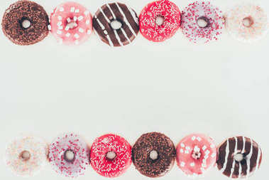 top view of frame made of various glazed doughnuts