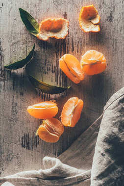 flat lay with tangerines and linen on wooden shabby surface