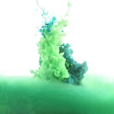 close up view of mixing of green and blue paint splashes isolated on white