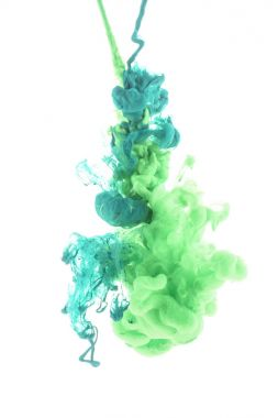 mixing of green paint splashes isolated on white