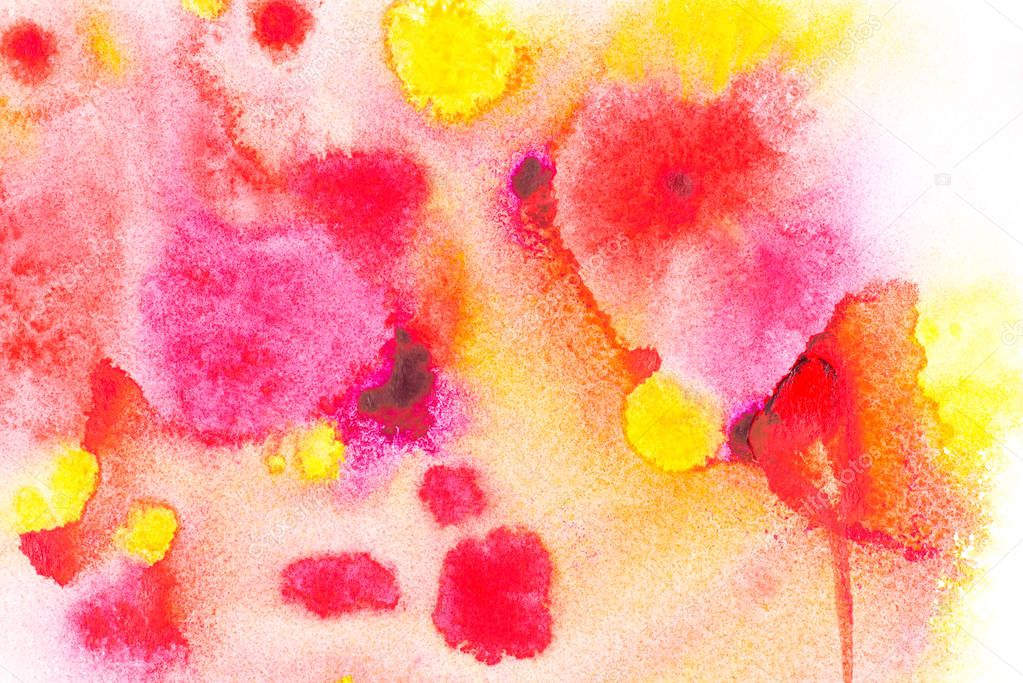 Abstract painting with bright red, pink and yellow watercolor paint blots on white