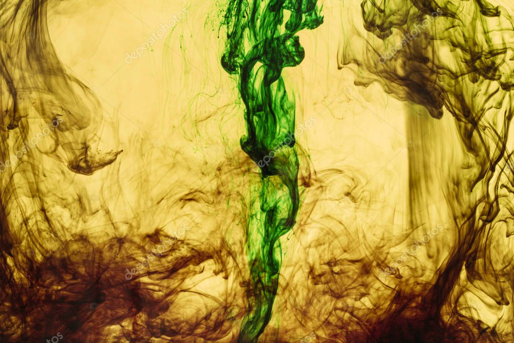 full frame of yellow and green paint splashes and swirls