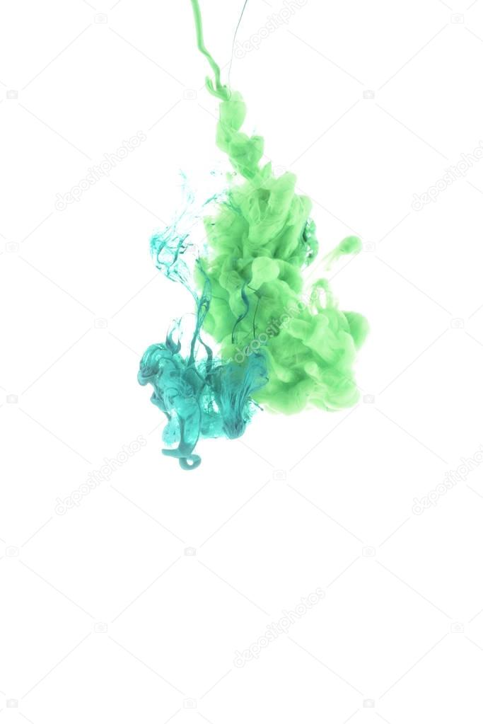 close up view of green and blue paint splashes isolated on white