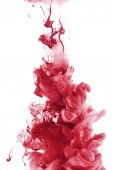 Fotografie red paint splash in water, isolated on white
