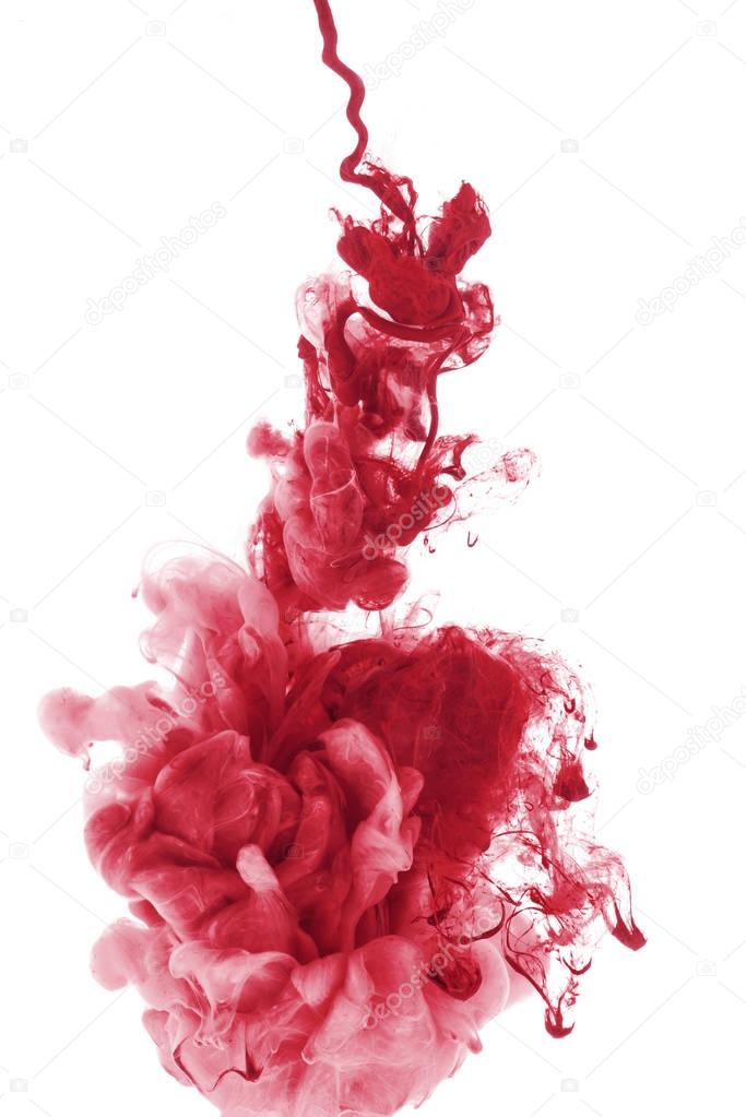 red paint splash in water, isolated on white