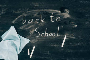 Top view of Back to school inscription on chalk board with cloth