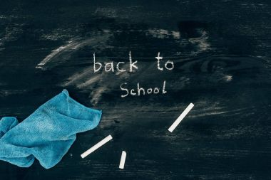 Top view of back to school inscription on chalk board with cloth stock vector