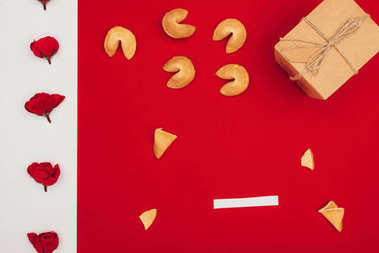 top view of chinese fortune cookies with flowers and gift box, Chinese New Year concept