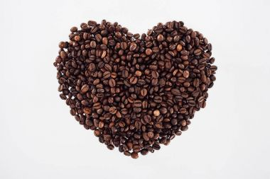 close-up view of heart made from roasted coffee beans isolated on white