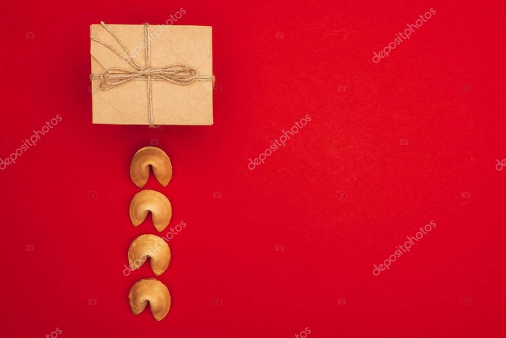 top view of chinese fortune cookies in row and box wrapped in kraft paper, Chinese New Year concept