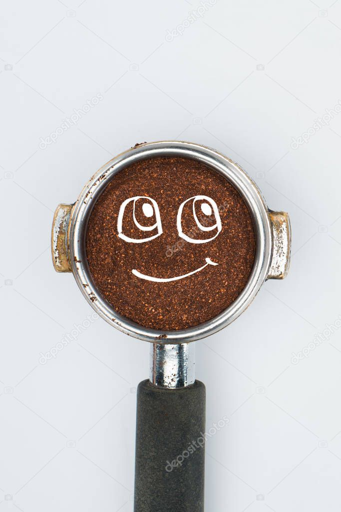 top view of coffee tamper with smiley face isolated on white