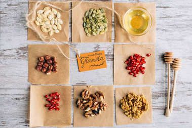 top view of granola ingredients with label on baking parchment pieces