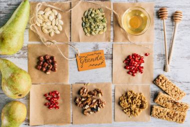 top view of granola ingredients and tag on baking parchment pieces