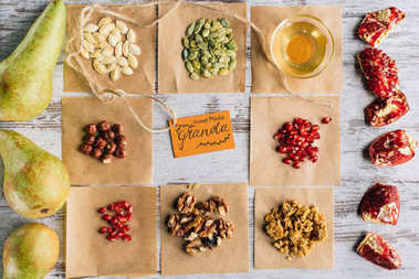 top view of granola ingredients and tag on wooden table