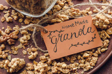 homemade crunchy granola with label on tray