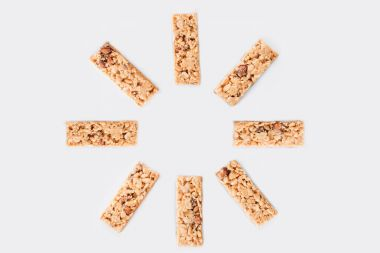 top view of sun shaped granola bars isolated on white