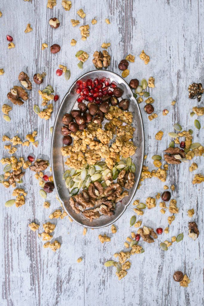 top view of granola ingredients on plate on wooden table