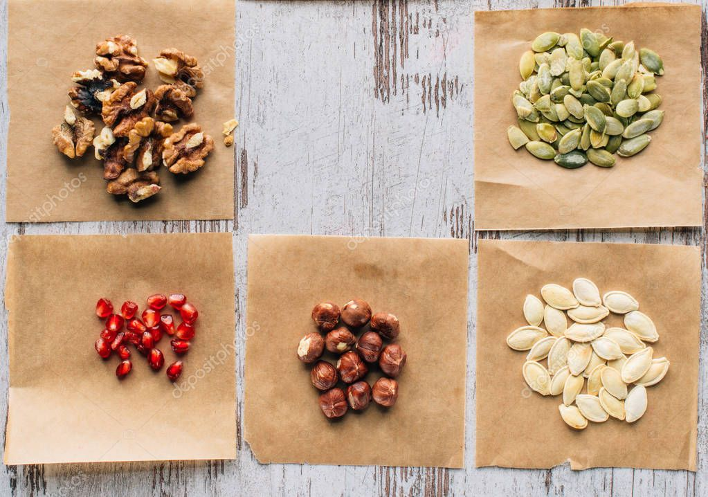 top view of nuts, pumpkin seeds and pomegranate seeds on table