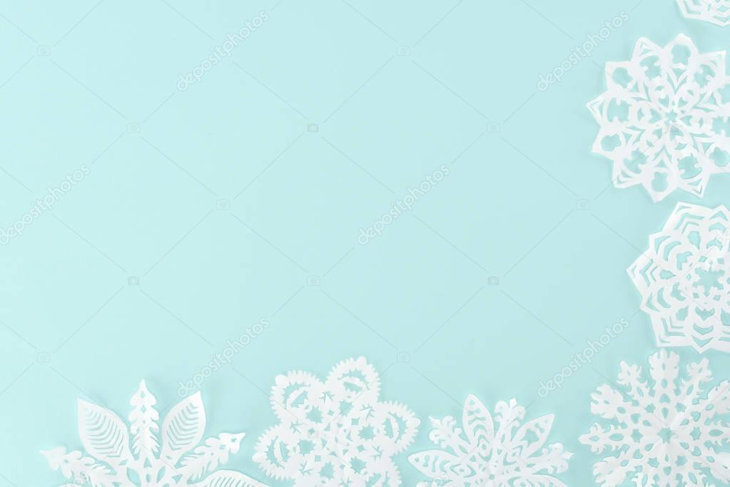 decorative christmas snowflakes, isolated on light blue with copy space