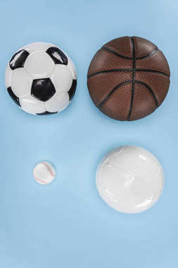 Balls for baseball, soccer, volleyball and basketball isolated on blue