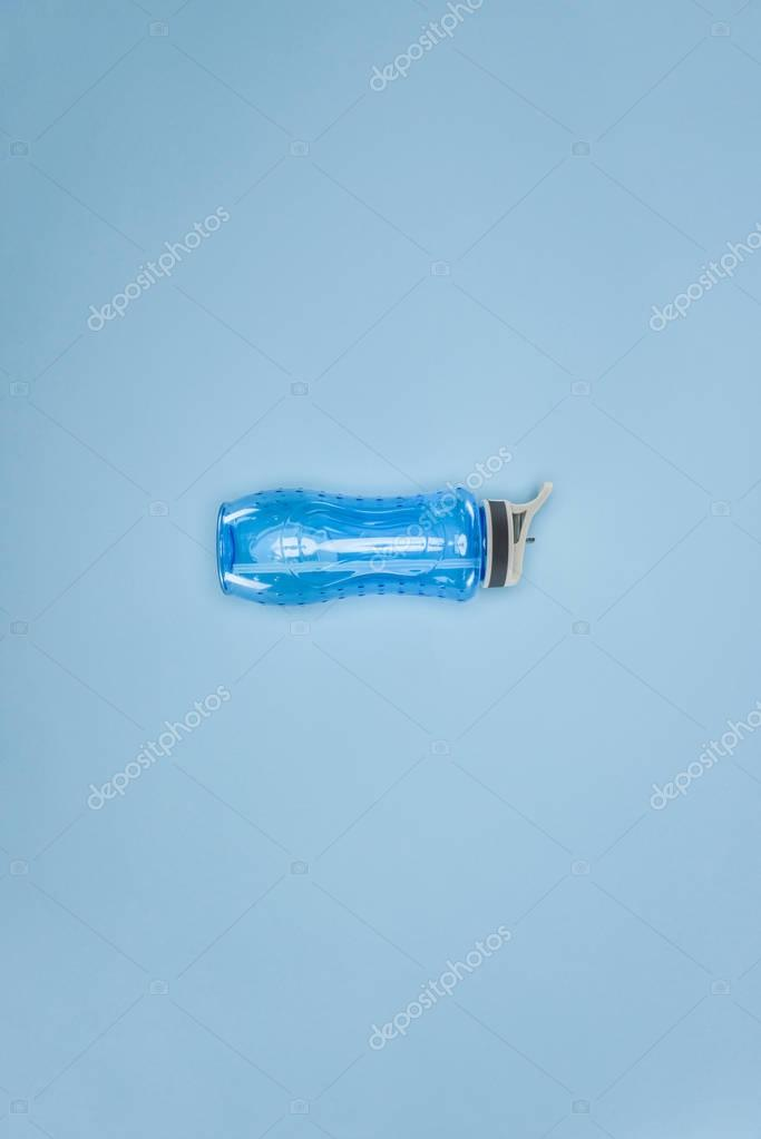 Sports water bottle isolated on blue background