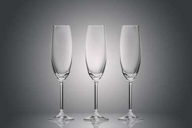 three empty clean glasses on grey