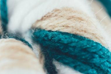 close up view of blue, beige and white knitting wool ball