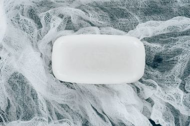 Top view of white soap on gauze stock vector