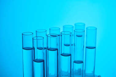 glass tubes with liquid for chemical test on blue