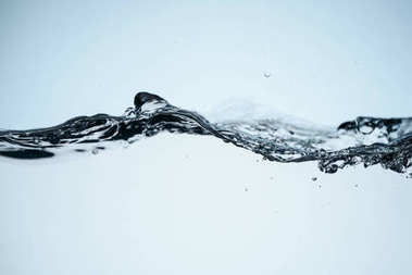 minimalistic background with flowing water, isolated on white