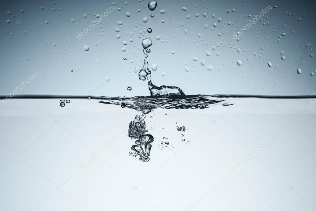 minimalistic background with water splash and bubbles, isolated on white