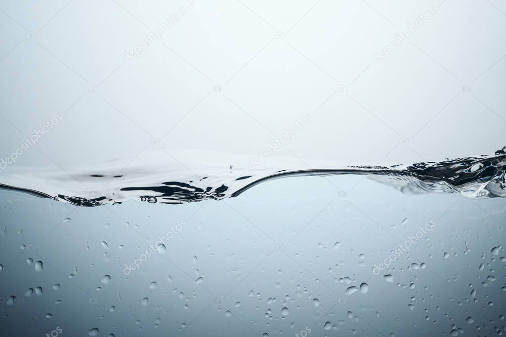 minimalistic texture with water splash and drops, isolated on white