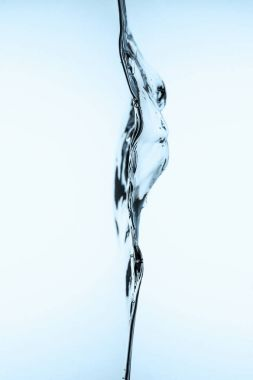 pouring clear water, isolated on white