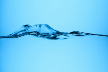 pure flowing water texture, isolated on blue