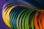 close up of colored quilling paper curves on purple