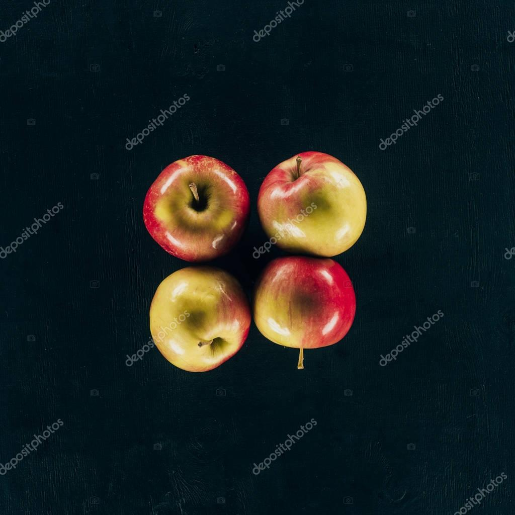 top view of arranged fresh apples isolated on black