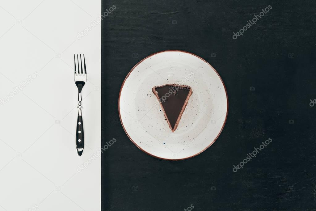 top view of piece of cake on plate and fork