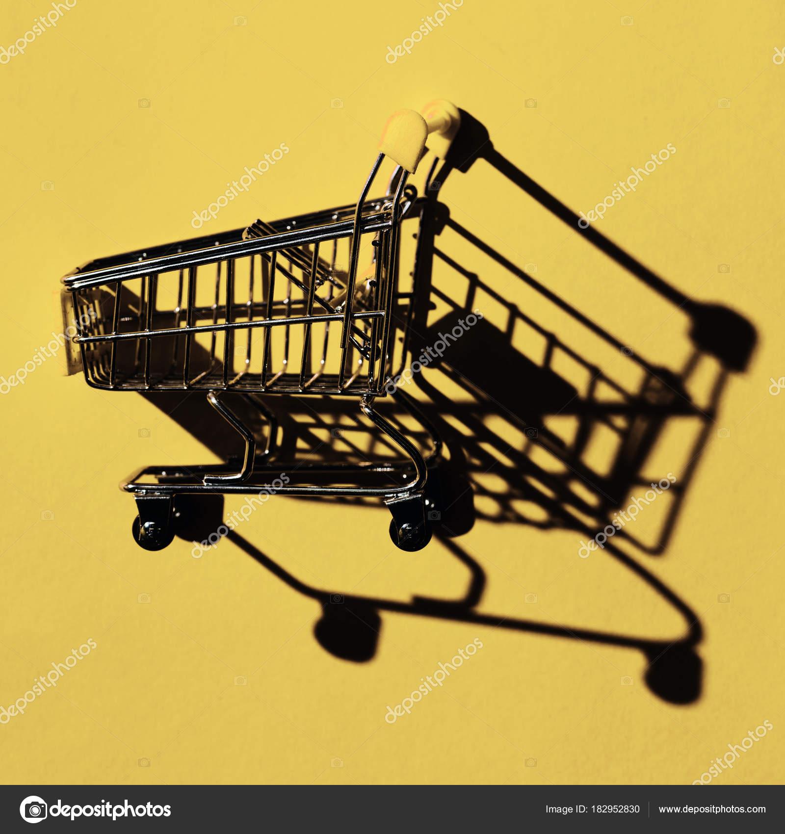 One Shopping Cart Shadow Yellow Wall — Stock Photo © VadimVasenin
