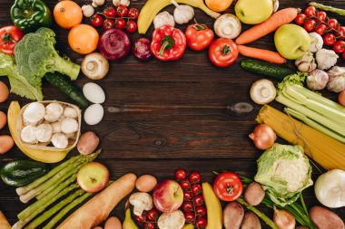 top view of vegetables and fruits on wooden table