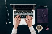 top view of businesswoman working with laptop isolated on black