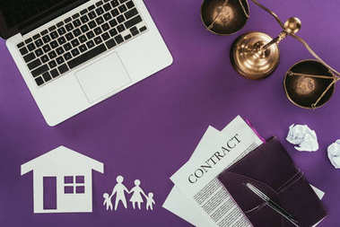 top view of business workplace with home and family insurance oncept on purple tabletop