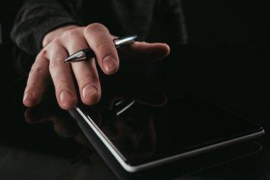 cropped shot of businessman using digital tablet