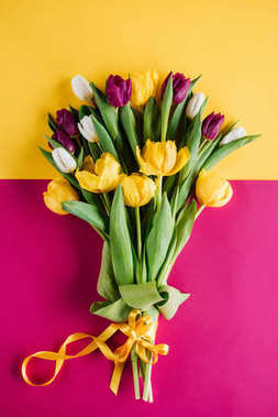 top view of spring tulips with ribbon for international womens day