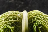 macro view of fresh healthy savoy cabbage on black